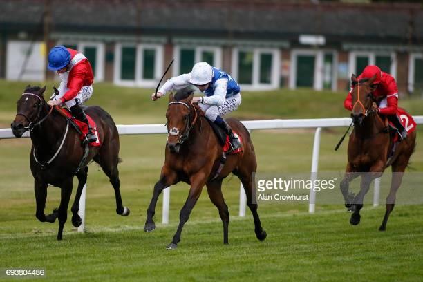 Oisin Murphy riding Looks A Million win The British Stallion Studs EBF Filliesâ Novice Stakes at Sandown racecourse on June 8 2017 in Esher England