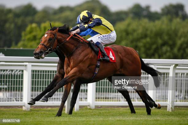 Oisin Murphy riding Surrey Hope win The Rainbow Trust Childrenâs Charity Handicap Stakes at Sandown racecourse on June 8 2017 in Esher England