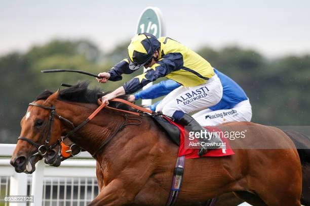 Oisin Murphy riding Surrey Hope win The Rainbow Trust Children's Charity Handicap Stakes at Sandown racecourse on June 8 2017 in Esher England