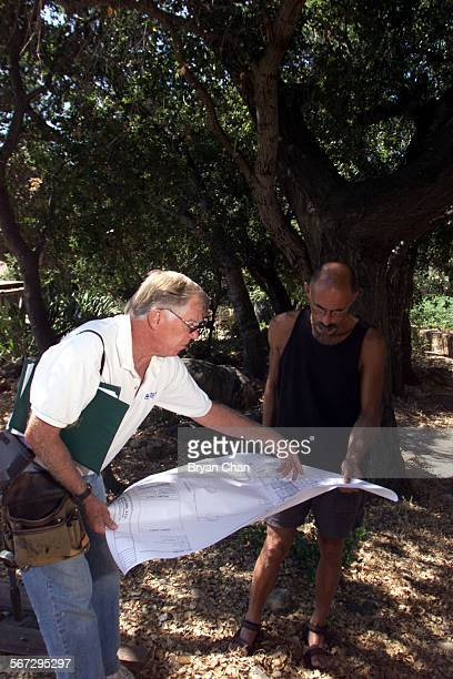 Ojai arborist Paul Rogers left goes over room addition plans with homeowner Jeff Skoff Skoff was planning to add a room to his Ojai home and...