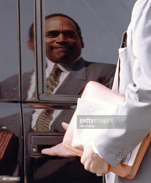 OJSimpson leaves court during noon recess MondayAs he sees him self in the window of his vehicle