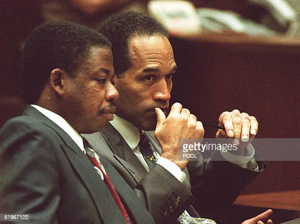 Simpson listens to one of his attorneys Carl Douglas during a short hearing 15 December 1994 in Los Angeles regarding a conversation Simpson had with...