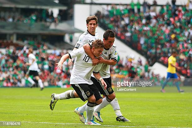 Okan Aydin and Levent Aycicek of Germany celebrate a scored goal against Brazil during the FIFA U17 World Cup Mexico 2011 3rd/4th play off match...