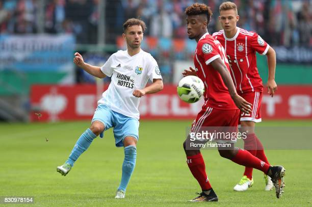 Okan Aydin of Cottbus competes with Kingsley Coman and Joshua Kimmich of Muenchen during the DFB Cup first round match between Chemnitzer FC and FC...