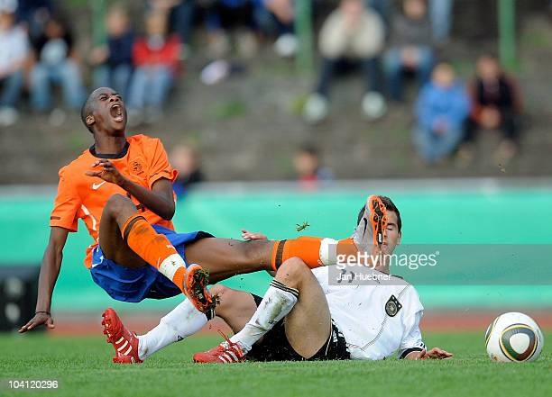 Okan Aydin of Germany battles for the ball with Terence Kongolo of the Netherlands during U17 International Friendly match between Germany and...
