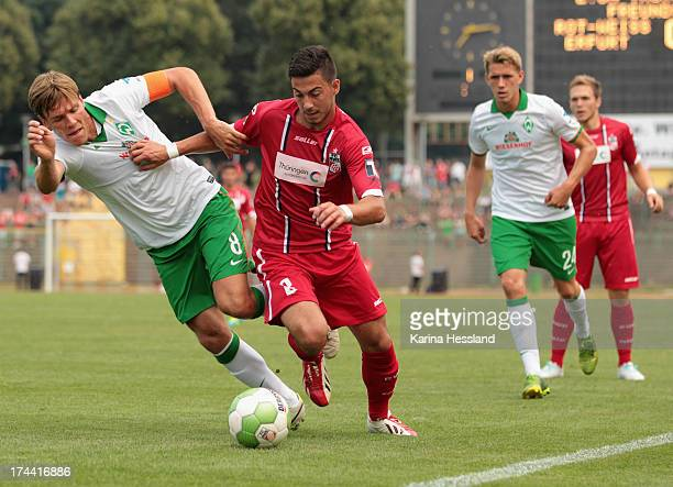 Okan Derici of Erfurt and Clemens Fritz of Bremen battle for the ball during the friendly match between RW Erfurt and SV Werder Bremen at...