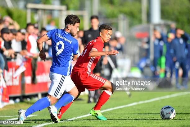 Okan Mete Yilmaz of Schalke 04 and Oliver Batista Meier of Bayern Muenchen compete for the ball during the B Juniors German Championship Semi Final...