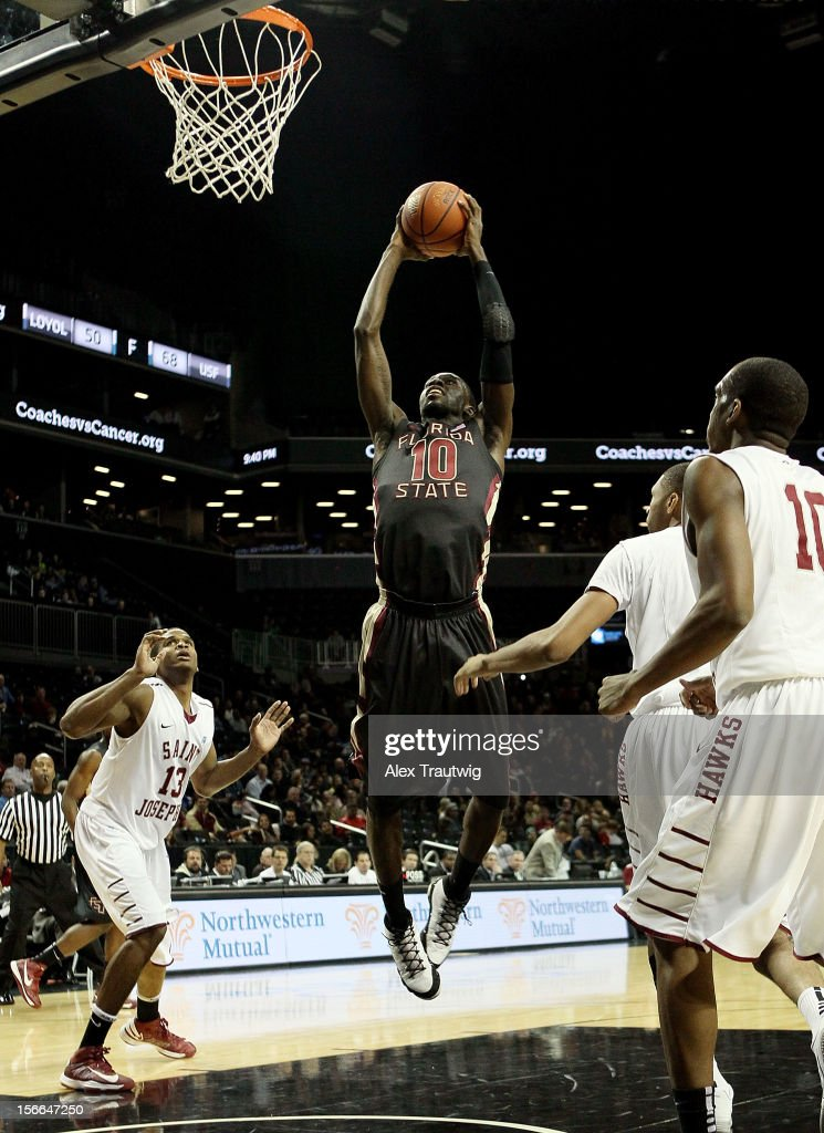 Okaro White #10 of the Florida State Seminoles dunks against the Saint Joseph's Hawks during the championship game of the Coaches Vs. Cancer Classic at the Barclays Center on November 17, 2012 in the Brooklyn borough of New York City.