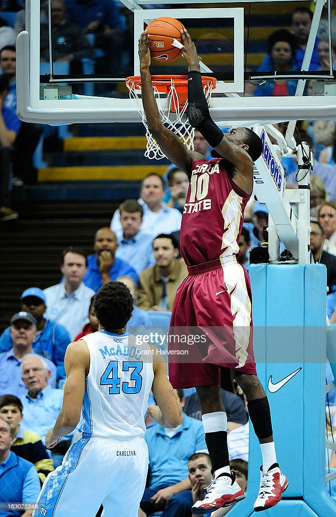 Okaro White #10 of the Florida State Seminoles dunks over James Michael McAdoo #43 of the North Carolina Tar Heels during play at Dean Smith Center on March 3, 2013 in Chapel Hill, North Carolina. North Carolina won 79-58.