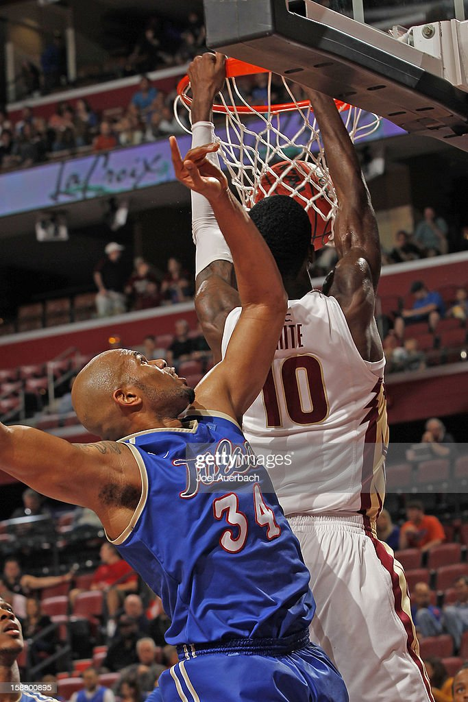 Okaro White #10 of the Florida State Seminoles dunks the ball past Scottie Haralson #34 of the Tulsa Golden Hurricane at the MetroPCS Orange Bowl Basketball Classic on December 29, 2012 at the BB&T Center in Sunrise, Florida. The Seminoles defeated the Golden Hurricane 82-63.