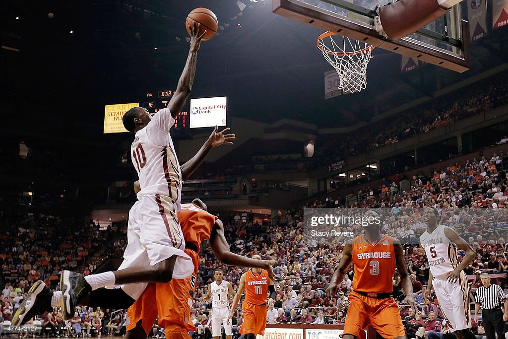 Okaro White of the Florida State Seminoles shoots over Rakeem Christmas of the Syracuse Orangemen during a game at the Donald L Tucker Center on...