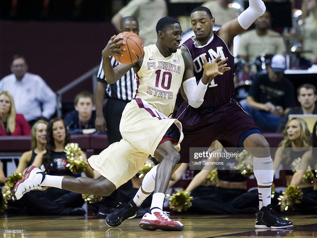 Okaro White #10 of the Florida State Seminoles tries to make his way by Jayon James #1 of the Louisiana-Monroe Warhawks during the game at the Donald L. Tucker Center on December 17, 2012 in Tallahassee, Florida.