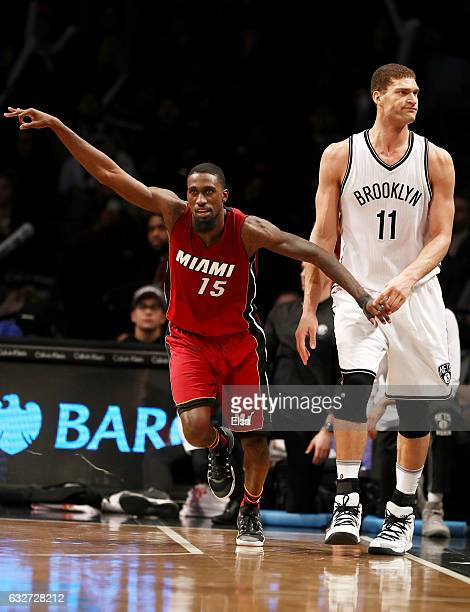 Okaro White of the Miami Heat celebrates his three point shot as Brook Lopez of the Brooklyn Nets reacts in the fourth quarter at the Barclays Center...
