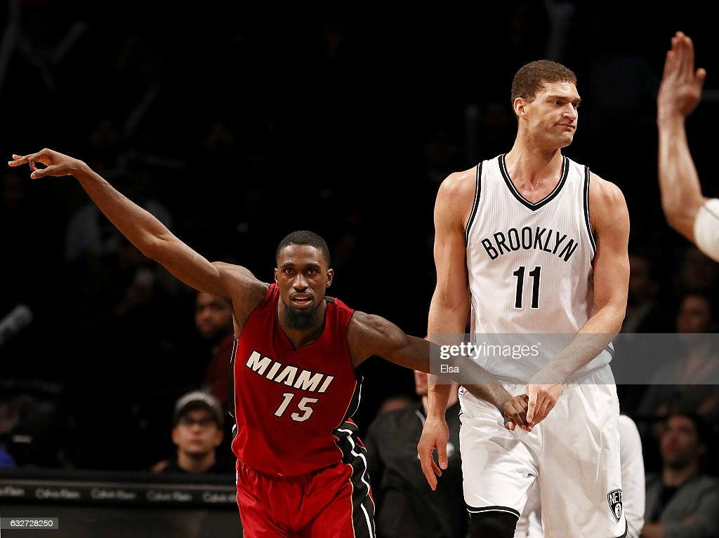 Okaro White #15 of the Miami Heat celebrates his three point shot as Brook Lopez #11 of the Brooklyn Nets reacts in the fourth quarter at the Barclays Center on January 25, 2017 in the Brooklyn borough of New York City.The Miami Heat defeated the Brooklyn Nets 109-106.