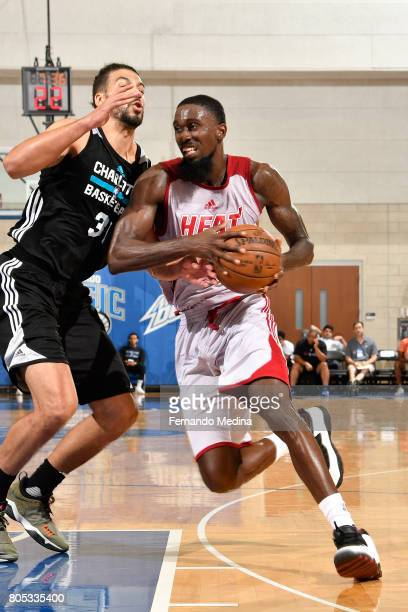 Okaro White of the Miami Heat handles the ball against the Charlotte Hornets during the 2017 Summer League on July 1 2017 at Amway Center in Orlando...