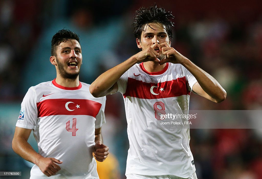 Okay Yokuslu (R) of Turkey celebrates after scoring his team's second goal during the FIFA U-20 World Cup Group C match between Australia and Turkey at Huseyin Avni Aker Stadium on June 28, 2013 in Trabzon, Turkey.