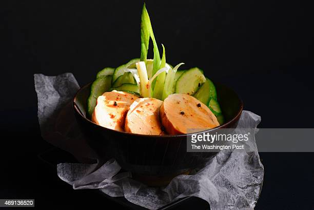 Oki Bowl's Monkfish liver appetizer garnished with cucumbers and scallions