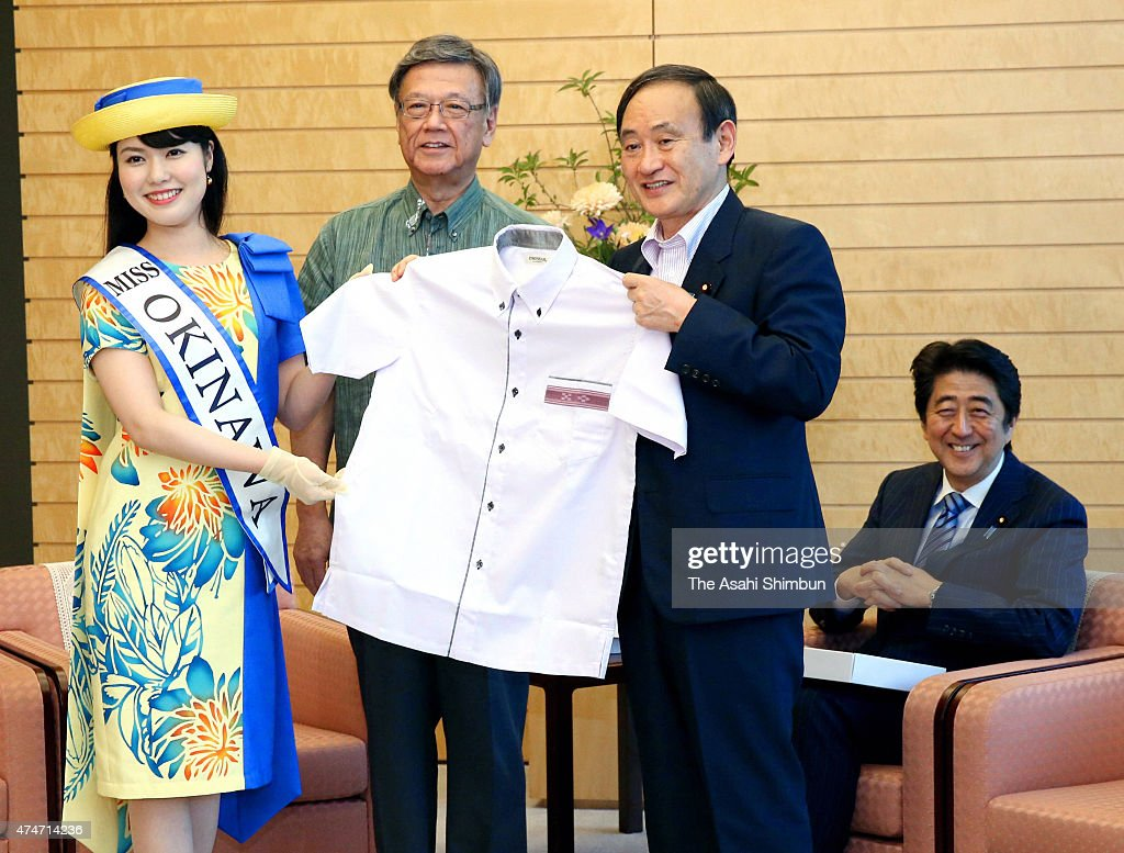 Okinawa Governor <a gi-track='captionPersonalityLinkClicked' href=/galleries/search?phrase=Takeshi+Onaga&family=editorial&specificpeople=9971702 ng-click='$event.stopPropagation()'>Takeshi Onaga</a> (2nd L) and Chief Cabinet Secretary <a gi-track='captionPersonalityLinkClicked' href=/galleries/search?phrase=Yoshihide+Suga&family=editorial&specificpeople=3868279 ng-click='$event.stopPropagation()'>Yoshihide Suga</a> (2nd R) pose with the 'Kariyushi' shirts, specialty of the southern island, while Prime Minister <a gi-track='captionPersonalityLinkClicked' href=/galleries/search?phrase=Shinzo+Abe&family=editorial&specificpeople=559017 ng-click='$event.stopPropagation()'>Shinzo Abe</a> (1st R) smiles at Abe's official residence on May 25, 2015 in Tokyo, Japan.