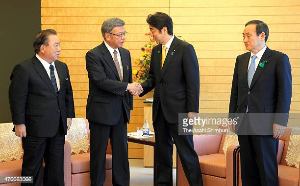 Okinawa Prefecture Governor Takeshi Onaga and Japanese Prime Minister Shinzo Abe shake hands prior to their first meeting at Abe's official residence...