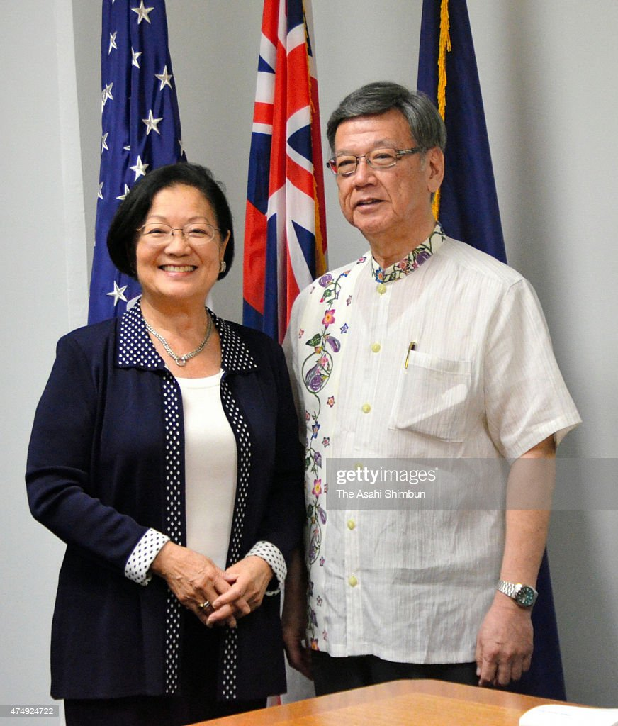 Okinawa Prefecture governor <a gi-track='captionPersonalityLinkClicked' href=/galleries/search?phrase=Takeshi+Onaga&family=editorial&specificpeople=9971702 ng-click='$event.stopPropagation()'>Takeshi Onaga</a> (R) and U.S. Senator <a gi-track='captionPersonalityLinkClicked' href=/galleries/search?phrase=Mazie+Hirono&family=editorial&specificpeople=3461717 ng-click='$event.stopPropagation()'>Mazie Hirono</a> pose for photographs during their meeting on May 27, 2015 in Honolulu, Hawaii.