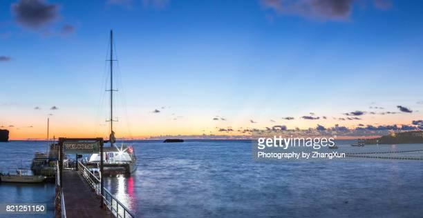 Okinawa sunset skyline at Manza beach with the background of cruise ship, sea and Sky, Naha, Okinawa, Japan.