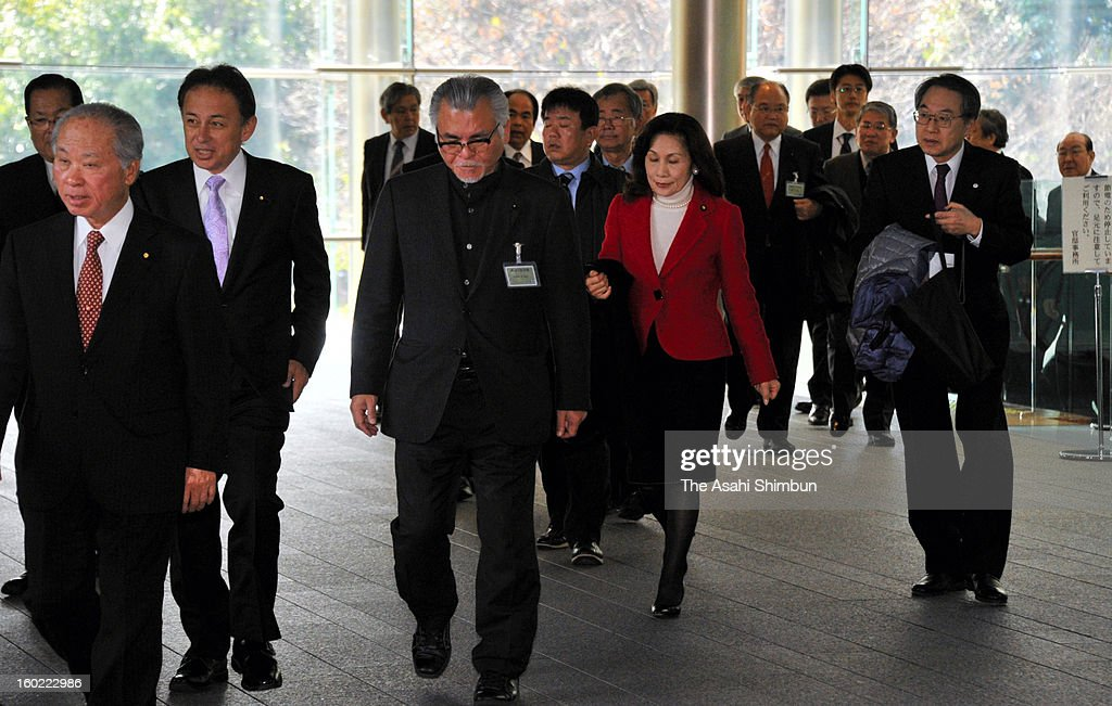 Okinawa's political leaders enter Prime Minister Shinzo Abe's official residence on January 28, 2013 in Tokyo, Japan. Okinawa's political leaders gather at Tokyo and request the withdrawal of U.S. Marine Corps Osprey aircraft deployment to Futenma Air Station.