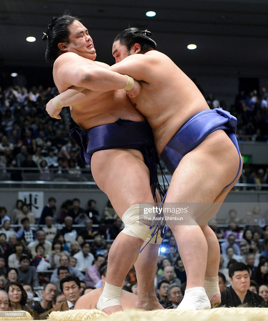 Okinoumi (R) pushes out Myogiryu to win during day fifteen of the Grand Sumo Spring tournament at Osaka Prefecture Gymnasium on March 24, 2013 in Osaka, Japan.