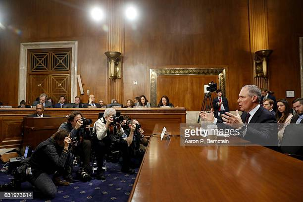 Oklahoma Attorney General Scott Pruitt Presidentelect Donald Trump's choice to head the Environmental Protection Agency testifies during his...