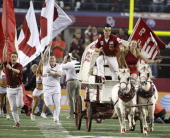 Oklahoma boosters fire up the crowd amid action against Texas AM in the ATT Cotton Bowl game in Cowboys Stadium in Arlington Texas on Friday January...