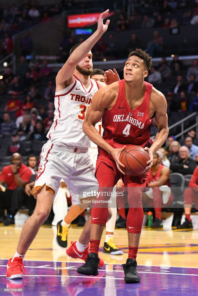 Oklahoma center Jamuni McNeace (4) makes a move inside during an college basketball game between the Oklahoma Sooners and the USC Trojans in the Basketball Hall of Fame Classic on December 8, 2017 at STAPLES Center in Los Angeles, CA.