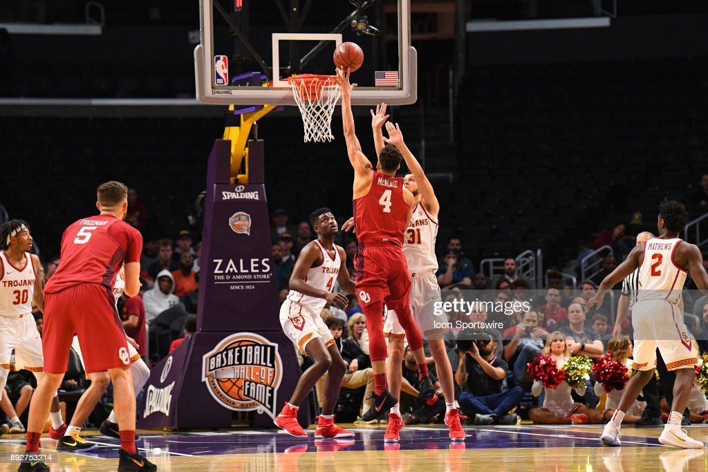 Oklahoma center Jamuni McNeace (4) shoots a hook shot over USC forward Nick Rakocevic (31) during an college basketball game between the Oklahoma Sooners and the USC Trojans in the Basketball Hall of Fame Classic on December 8, 2017 at STAPLES Center in Los Angeles, CA.