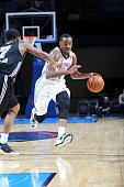 Oklahoma City Blue Marquis Teague dribbles the ball against Bryce Cotton of the Austin Spurs during an NBA DLeague game on November 30 2014 at the...