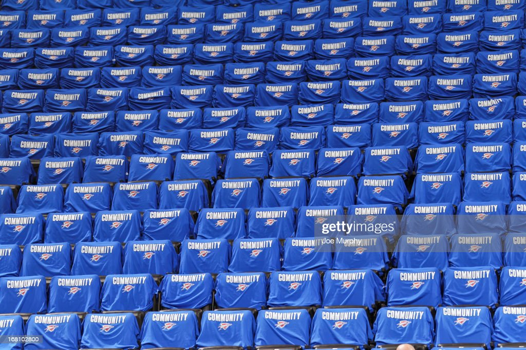 Oklahoma City Thunder 'Community' T-shirts await fans on seats before the Memphis Grizzlies played the Thunder in Game One of the Western Conference Semifinals during the 2013 NBA Playoffs on May 5, 2013 at the Chesapeake Energy Arena in Oklahoma City, Oklahoma.