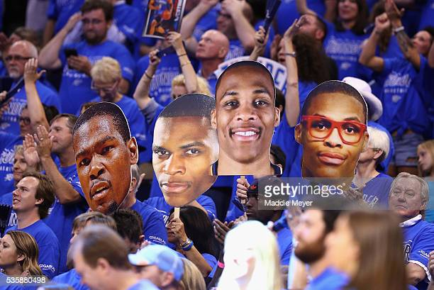 Oklahoma City Thunder fans hold signs in game six of the Western Conference Finals between the Oklahoma City Thunder and the Golden State Warriors...