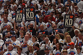 Oklahoma City Thunder fans hold up signs during Game Four of the Western Conference Finals against the Golden State Warriors during the 2016 NBA...