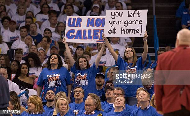 Oklahoma City Thunder fans taunt Dallas Mavericks players during the first half of Game One of the Western Conference Quarterfinals during the 2016...