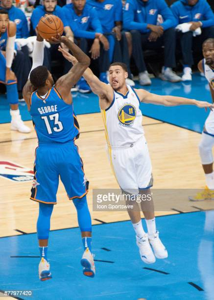 Oklahoma City Thunder Forward Paul George pulls up for a jumper while Golden State Warriors Guard Klay Thompson tries to block the shot at the...