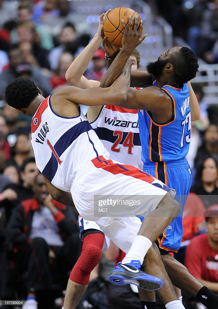 Oklahoma City Thunder guard James Harden (13) gets fouled while defended by Washington Wizards shooting guard Nick Young (1) and Wizards forward Jan Vesely (24) during the third quarter at the Verizon Center in Washington, D.C., Wednesday, January 18, 2012. The Wizards defeated the Thunder, 105-102.