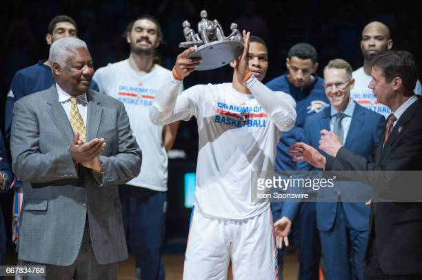 Oklahoma City Thunder Guard Russell Westbrook accepts the award from NBA legend Oscar Robertson on April 12 at the Chesapeake Energy Arena Oklahoma...