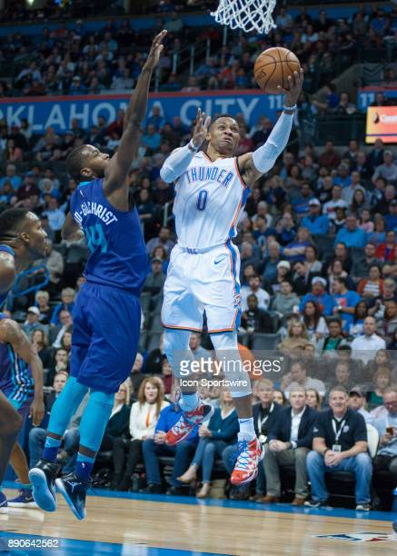 Oklahoma City Thunder Guard Russell Westbrook making his way to the basket while Charlotte Hornets Forward Michael KiddGilchrist plays defense on...