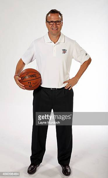 Oklahoma City Thunder head coach Scott Brooks poses for a portrait during 2014 NBA Media Day on September 29 2014 at the Thunder Events Center in...