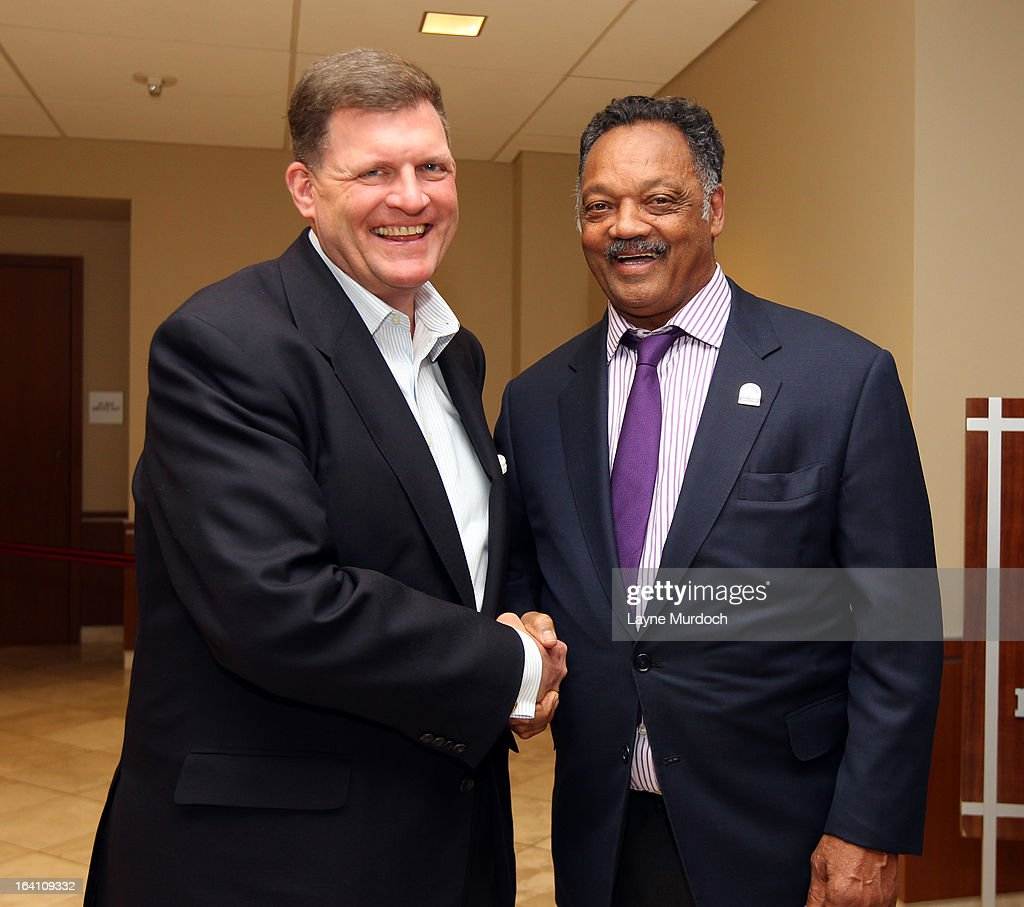 Oklahoma City Thunder owner Clay Bennett greets Reverend Jesse Jackson after his team played the Denver Nuggets on March 19, 2013 at the Chesapeake Energy Arena in Oklahoma City, Oklahoma.