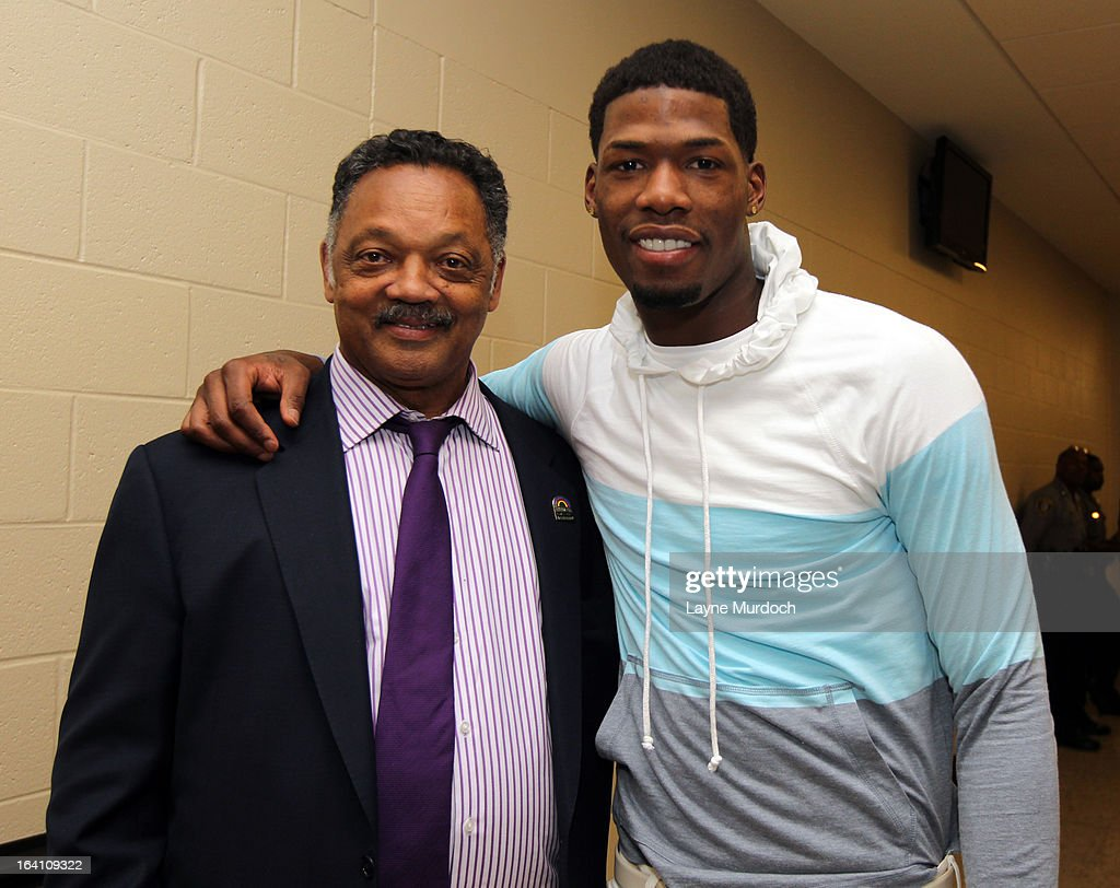 Oklahoma City Thunder player DeAndre Liggins #25 greets Reverend Jesse Jackson after the Thunder played the Denver Nuggets on March 19, 2013 at the Chesapeake Energy Arena in Oklahoma City, Oklahoma.