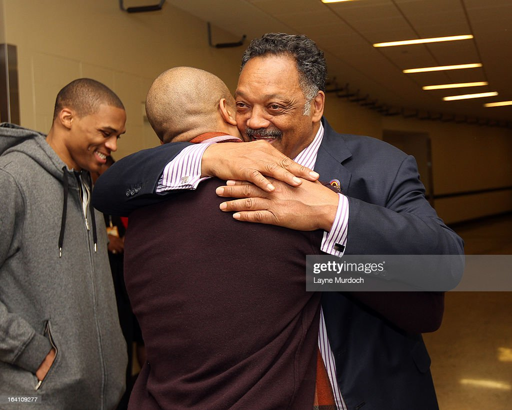 Oklahoma City Thunder player Derek Fisher #6 greets Reverend Jesse Jackson after the Thunder played the Denver Nuggets on March 19, 2013 at the Chesapeake Energy Arena in Oklahoma City, Oklahoma.