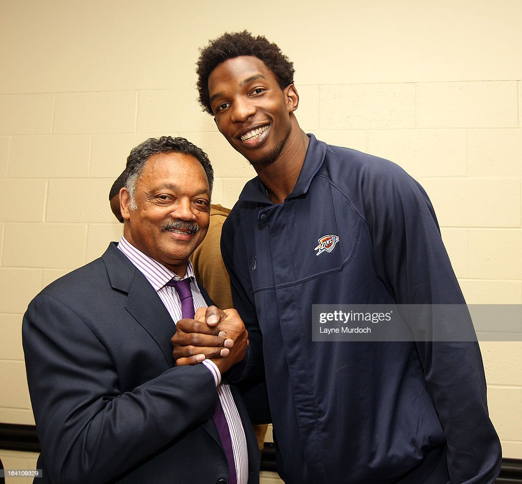 Oklahoma City Thunder player Hasheem Thabeet #34 greets Reverend Jesse Jackson after the Thunder played the Denver Nuggets on March 19, 2013 at the Chesapeake Energy Arena in Oklahoma City, Oklahoma.