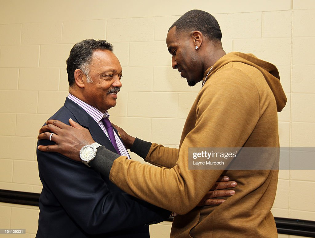 Oklahoma City Thunder player Kendrick Perkins #5 greets Reverend Jesse Jackson after the Thunder played the Denver Nuggets on March 19, 2013 at the Chesapeake Energy Arena in Oklahoma City, Oklahoma.