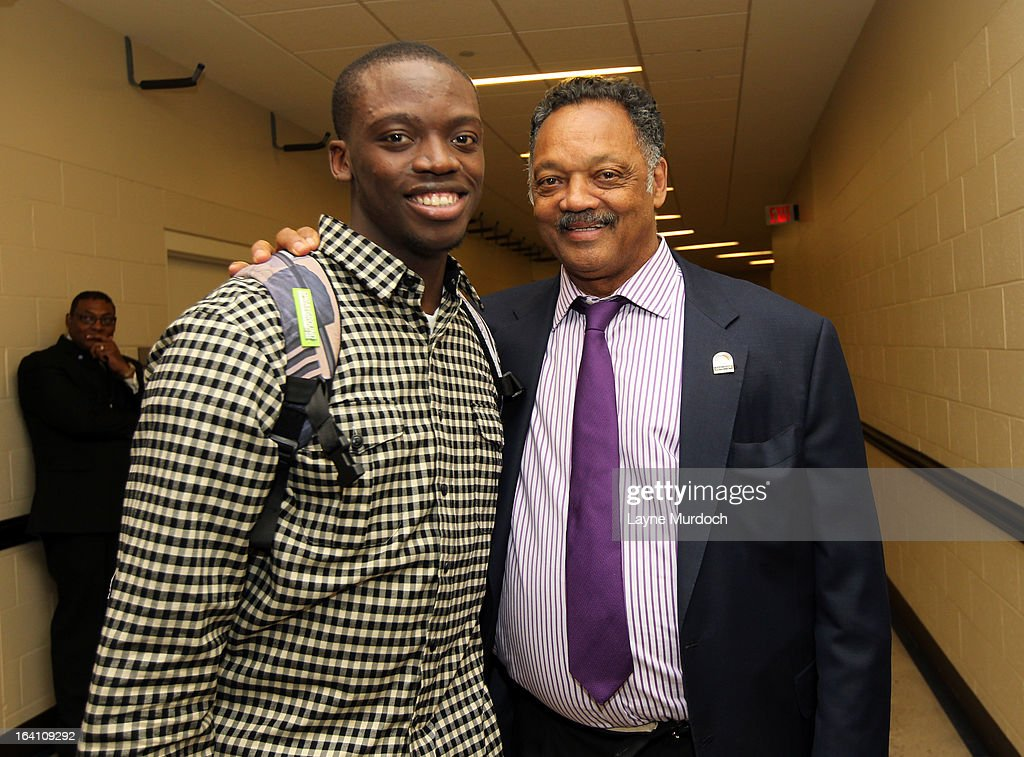 Oklahoma City Thunder player Reggie Jackson #15 greets Reverend Jesse Jackson after the Thunder played the Denver Nuggets on March 19, 2013 at the Chesapeake Energy Arena in Oklahoma City, Oklahoma.