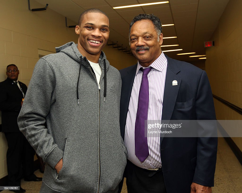 Oklahoma City Thunder player Russell Westbrook #0 greets Reverend Jesse Jackson after the Thunder played the Denver Nuggets on March 19, 2013 at the Chesapeake Energy Arena in Oklahoma City, Oklahoma.