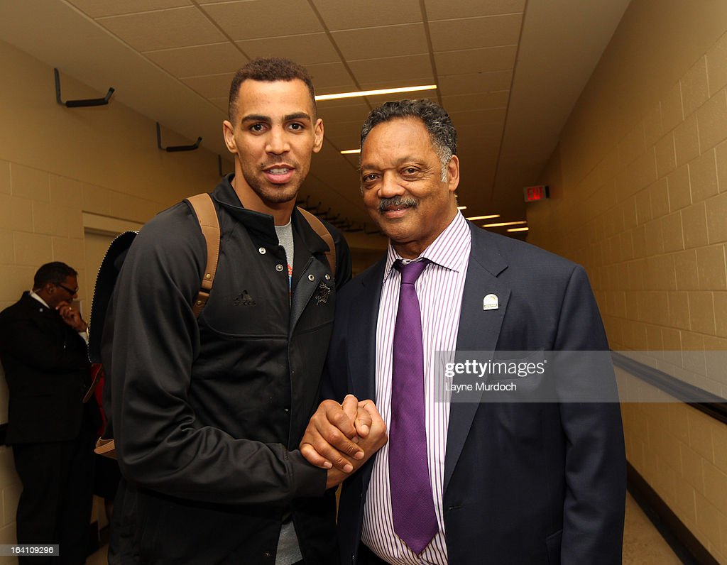 Oklahoma City Thunder player Thabo Sefolosha #2 greets Reverend Jesse Jackson after the Thunder played the Denver Nuggets on March 19, 2013 at the Chesapeake Energy Arena in Oklahoma City, Oklahoma.