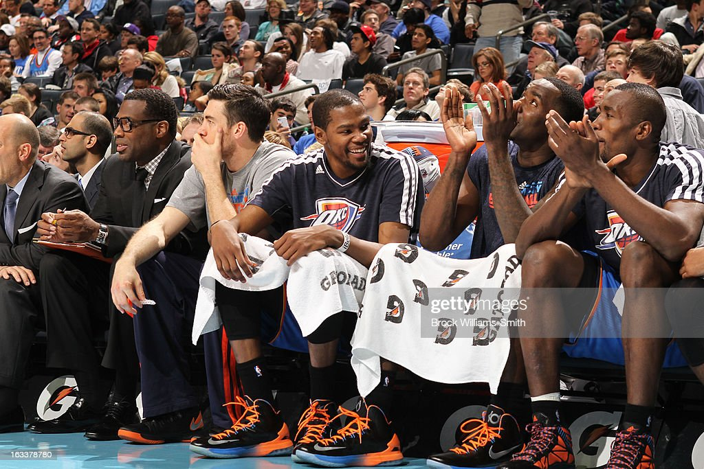 Oklahoma City Thunder players enjoy the game against the Charlotte Bobcats at the Time Warner Cable Arena on March 8, 2013 in Charlotte, North Carolina.